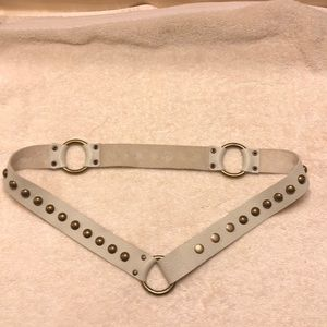 Studded cream colored belt